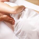 Почему при беременности болит поясница